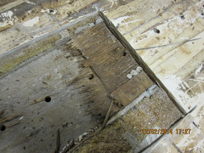 A close-up of the laminate with screw holes going through the laminate. Water was leaking into the laminate and the wood was soaked. It is now replaced the proper way with solid GRP and Divinycell.