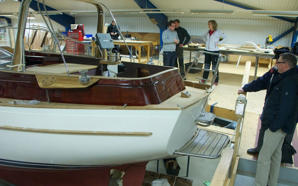 Nautical Channel admiring a classic Vindö being refitted