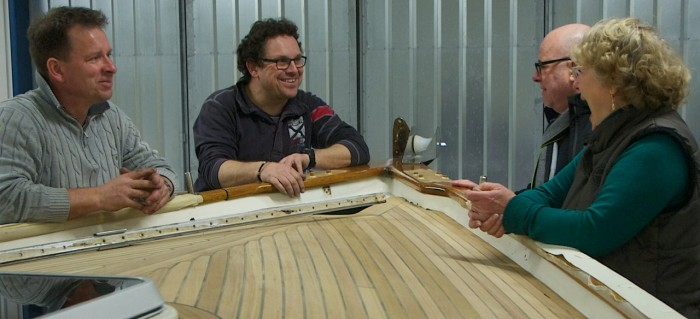 Kai (left) and Carl (second from left) proudly show the details and the efforts that have been put into the teak deck for Rudolf and Doris (right)