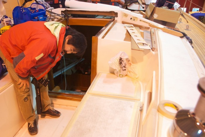 Yoshi Wakao investigating in detail how Adams Boat Care works and wishes to understand how the refit is being done on Regina Laska.