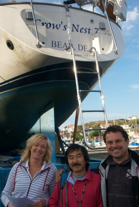 Anna Friberg (left) and Carl Adams (right) welcoming Yoshi Wakao (middle) to Ellös after a 6,300 miles sail to get Crown's Nest refitted by Adams Boat Care.